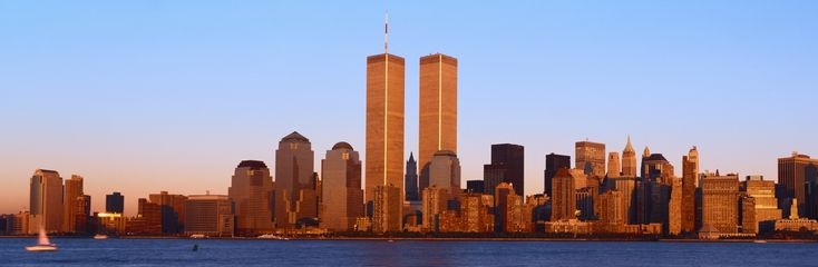 Lower Manhattan skyline with World Trade Towers at sunset