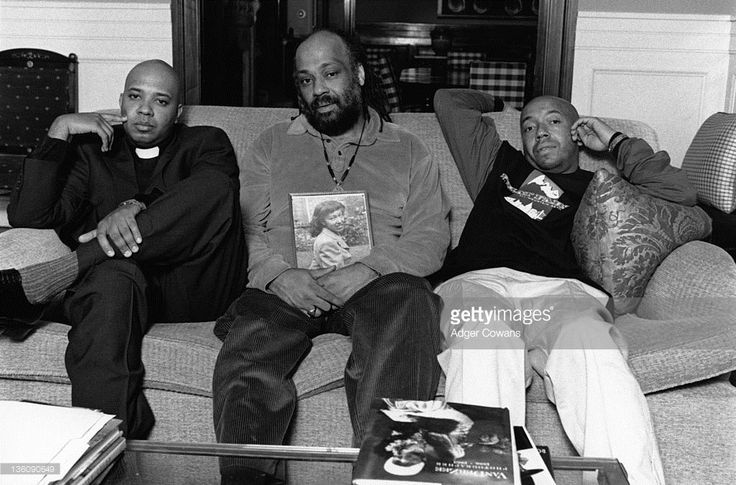 Portrait of the Simmons brothers, from left, musician Joseph Simmons (also known as Reverend Run of Run DMC), painter Danny Simmons, and businessman and producer Russell Simmons, 2000.