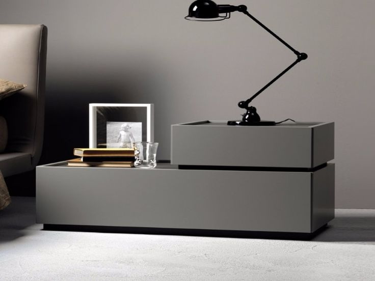 Gorgeous gray nightstand design with contemporary lines that's perfect for modern master bedrooms.