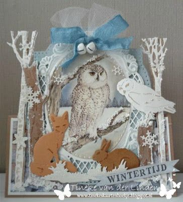 Handmade card by DT member Tineke with among others Creatables Anja's Oval (LR0376), Craftables Tiny's Trees Birch (CR1337), Tiny's Trees Oak (CR1338), Tiny's Fox & Pheasant (CR1341), Squirrel & Rabbit (CR1340) and Punch Die - Snowfakes (CR1335) from Marianne Design