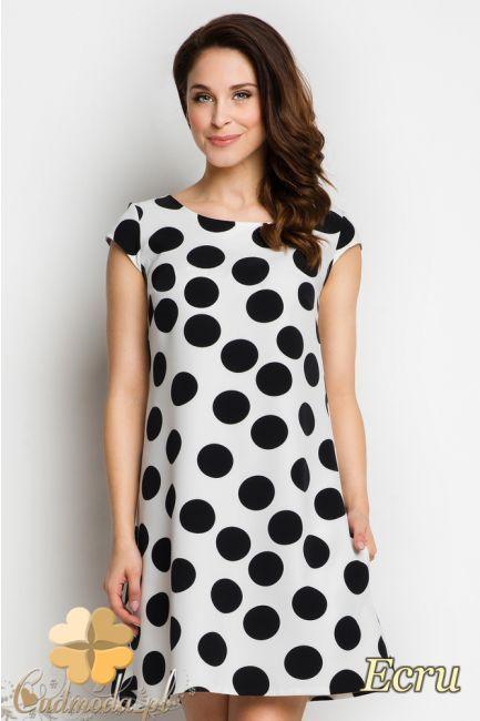 Rozkloszowana sukienka mini w kropki.