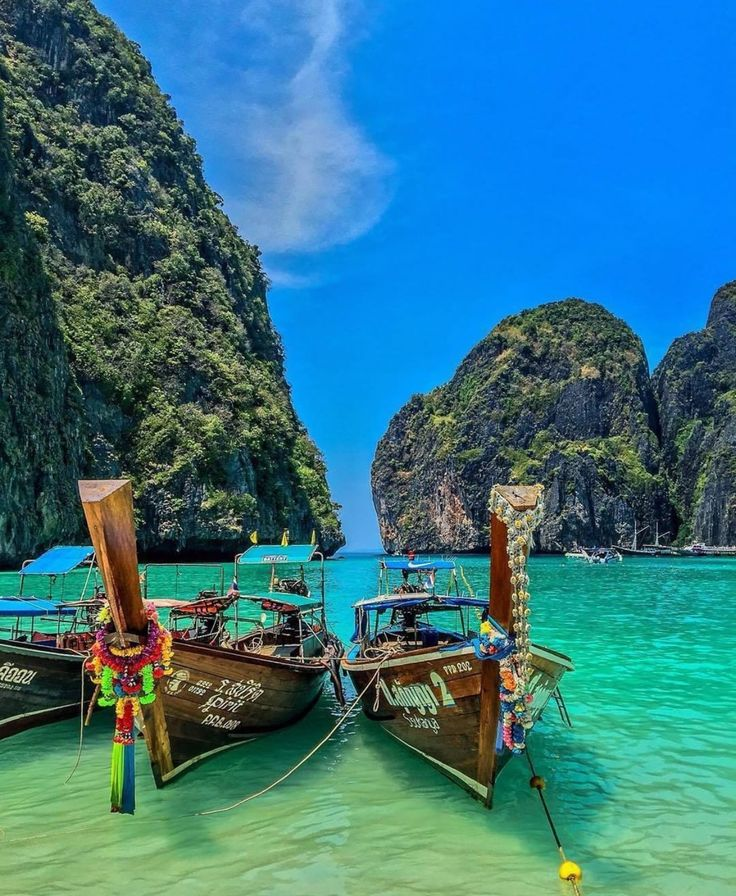 Phi Phi Islands - Phi Phi Island is Thailand's island-superstar. It's been in the movies. It's the topic of conversation for travelers all over Thailand. For some, it's the only reason to touchdown in Phuket. Even with all the hype, it doesn't disappoint. Phi Phi's beauty is a large chunk of the allure. The islands, when approached by boat, rise from the sea like a fortress. Sheer cliffs tower overhead, then give way to beach-fronted jungle. It's love at first sight.