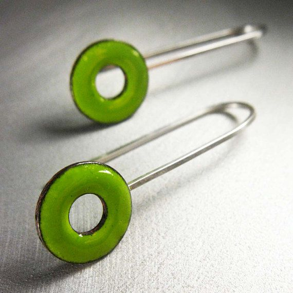 Tempting new ear candy to compliment my Lifesaver rings! Luscious bright lime green glass enamel kiln-fired onto a copper O-ring shape suspended by a slender yet sturdy wire of sterling silver. A charming style that you can dress up or down. These earrings are feather-light! The