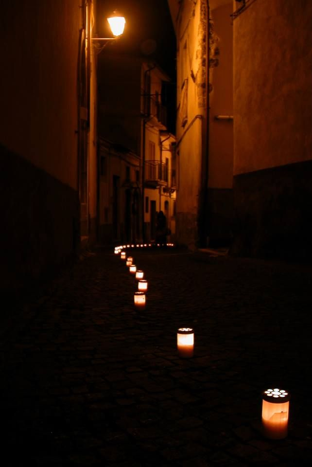 Outdoor 2013: contemporary art event in one of the most authentic medieval villages of Abruzzo, Italy.  A night tour through the narrow dark alleys of Castelvecchio Subequo (AQ), illuminated by votive candles of MUSA Project.  #art #design #contemporaryart #italy