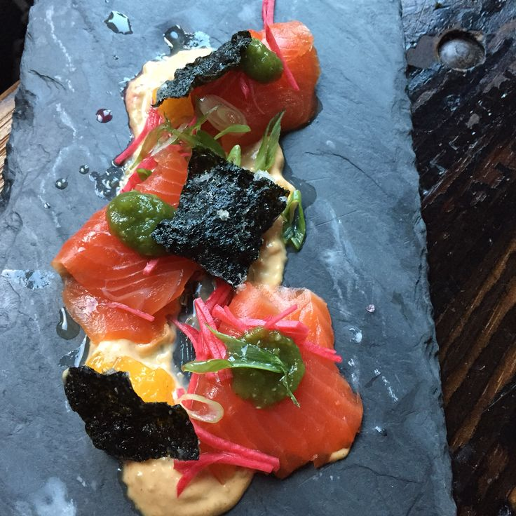A stunning in house smoked trout plate with spicy remoulade, seaweed crackers, oranges and pickled onions.