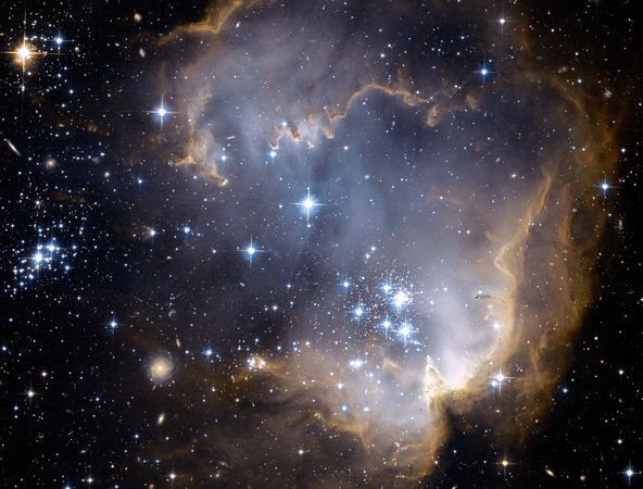 Hubble Photo of the stellar nursery known as NGC 602 released in January 2007- One of my favorites, looks like a dinosaur eating stars. :)