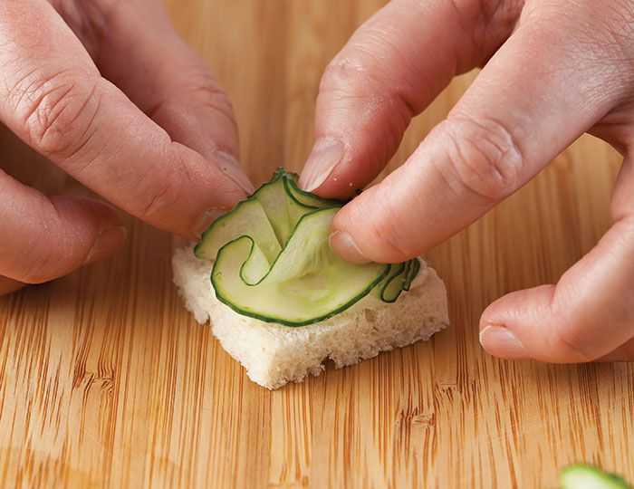 Follow these steps to make the cucumber flowers in Cucumber Flower Canapés.
