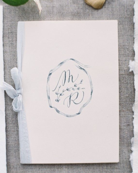 The couples' initials were digitally printed on a card stock cover; the booklet was then tied with Froufrou Chic hand-dyed silk ribbon.