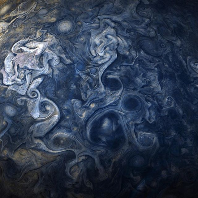 Jupiter, you're bluetiful 💙! Churning swirls of Jupiter's clouds are seen in striking shades of blue in this new view taken by our Juno spacecraft (@NASAJuno). The color-enhanced image was taken when the spacecraft was only 11,747 miles from the tops of the planet's clouds.  This color-enhanced image, which captures a cloud system in Jupiter's northern hemisphere, was taken on Oct. 24 when Juno was performing its ninth close flyby of the gas giant planet.  Because of the Juno-Jupiter-Sun…