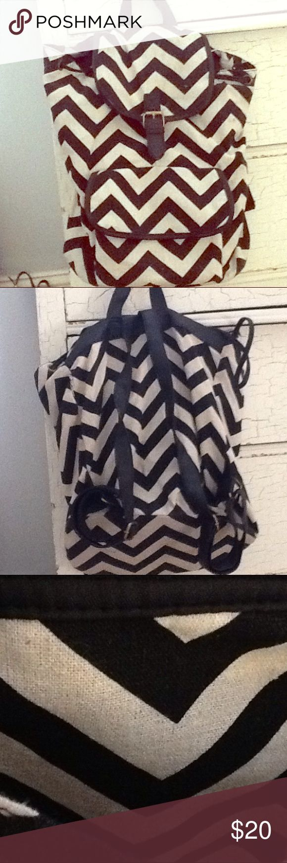 Black Chevron Backpack It has two pockets, the main one and the outer pocket with a zip up compartment and two other pockets inside. It is super cute and roomy. Bags Backpacks