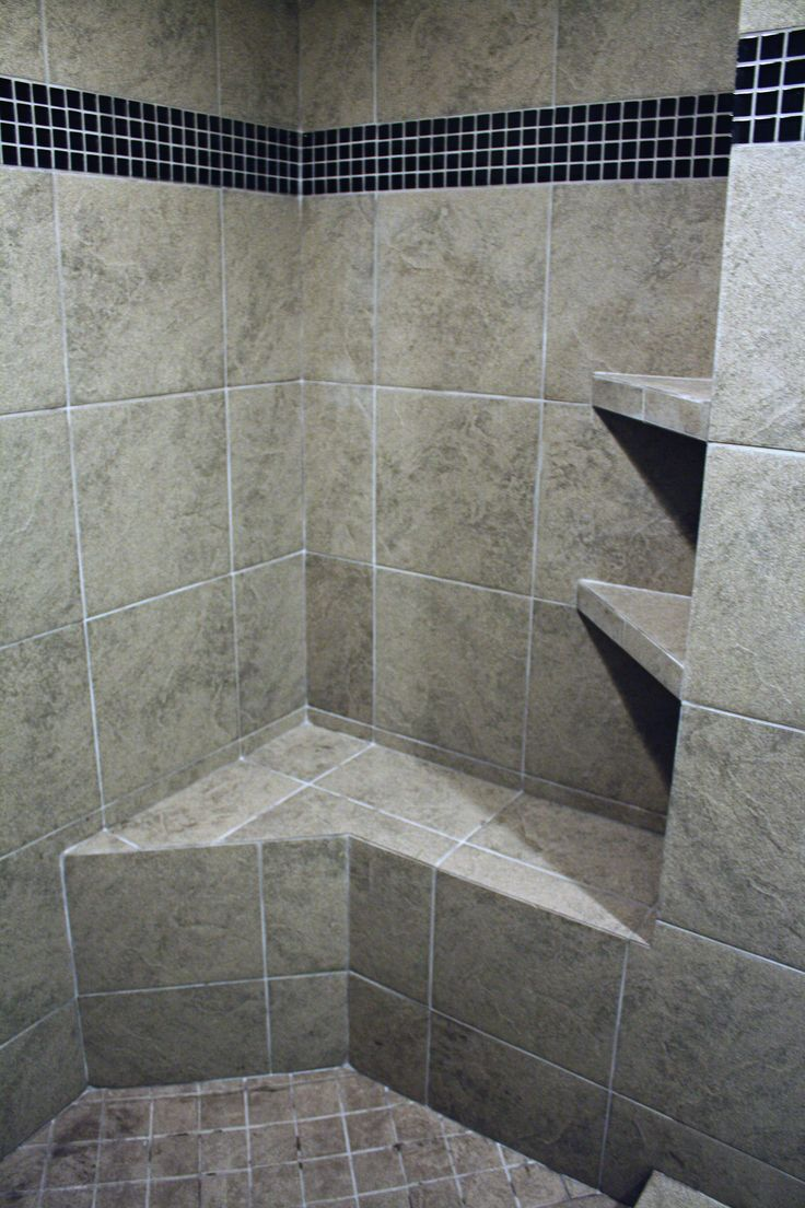 Love the bench and shelving in this customer ceramic tile shower design.