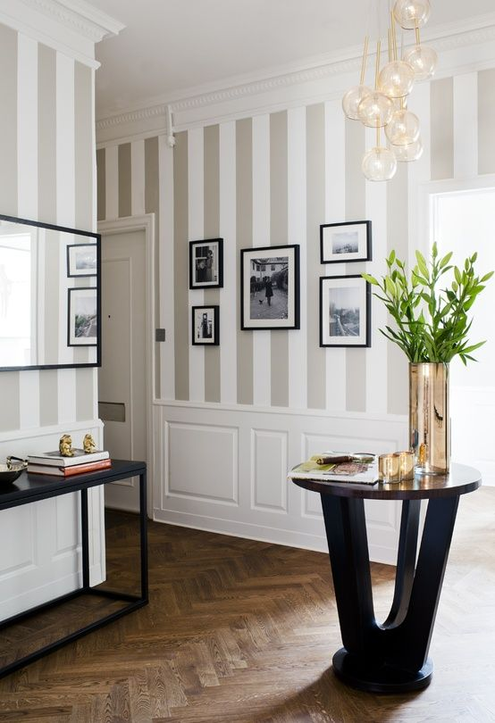 Love the wainscoting (sp?) with the vertical stripes. Dining room?