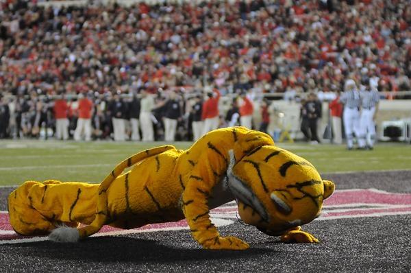 University of Missouri mascot Truman the Tiger does push-ups after each Mizzou score.