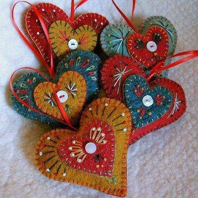 """FeltSewGood: New Holiday """"Heart Felt"""" Ornaments  made from felted recycled wool sweaters. They are embroidered in traditional Christmas colors of red, gold, dark green, light green & cream and accented with a tiny vintage button. They are blanket stitched around the edge, """"puffed"""" with a little stuffing & has a tiny red satin ribbon loop for hanging. The back of each is unadorned."""