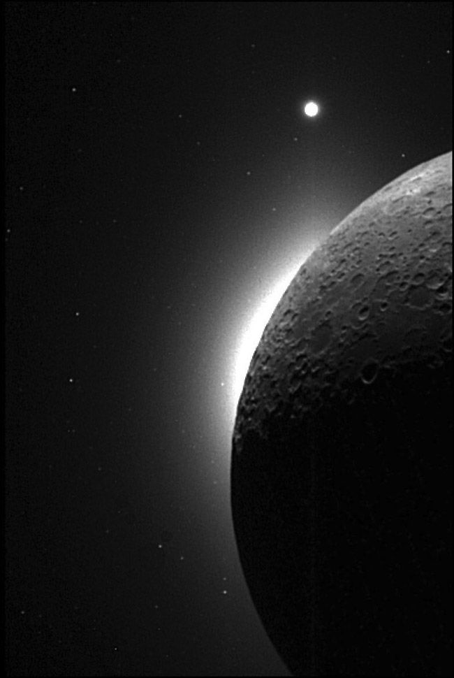 View from the Clementine probe with the sun behind the moon. Venus can be seen in the top of the image. 1994