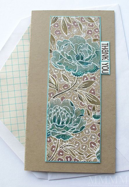 Stamped on Kraft cardstock using Colorbox White pigment ink  Then heat embossed with white embossing powder.  Painted with Distress Inks & intensified with Copic markers  Then painted over with Perfect Pearls.)