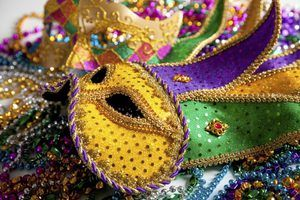 "Brilliant color and over-the-top decorations link Mardi Gras costumes and Twelfth Night ""mumming."""