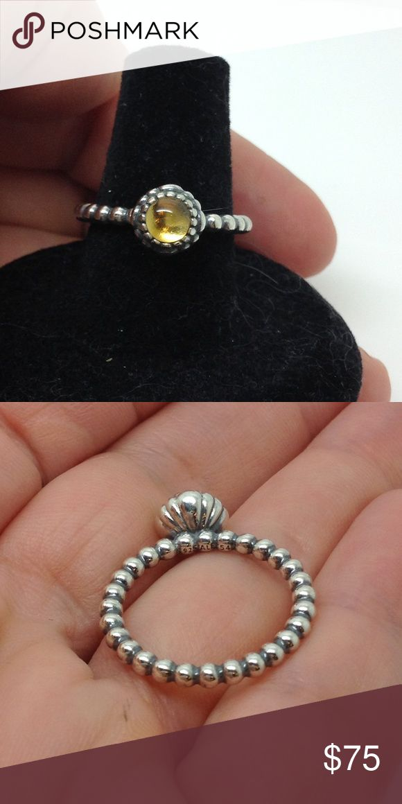 Pandora Sterling yellow citrine stacking ring Firm price. November's birthstone, the glowing yellow citrine, is bright and lovely on this sterling silver stacking bubble ring. The citrine is said to represent prosperity and success, and is a warm and sunny piece for an all-silver or gold-and-silver ring stack. pandora Jewelry Rings