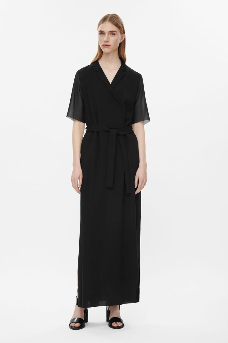 Made from a fluid raw-cut crepe this dress has a double-breasted button fastening at the front with a detachable belt. An elongated shape, it has a collared v-neckline, split hemlines, in-seam pockets and short sleeves.