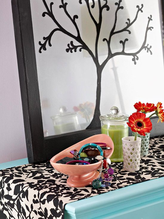 Take an old mirror (or new one) spray on a Mirror Finish then paint a silhouette