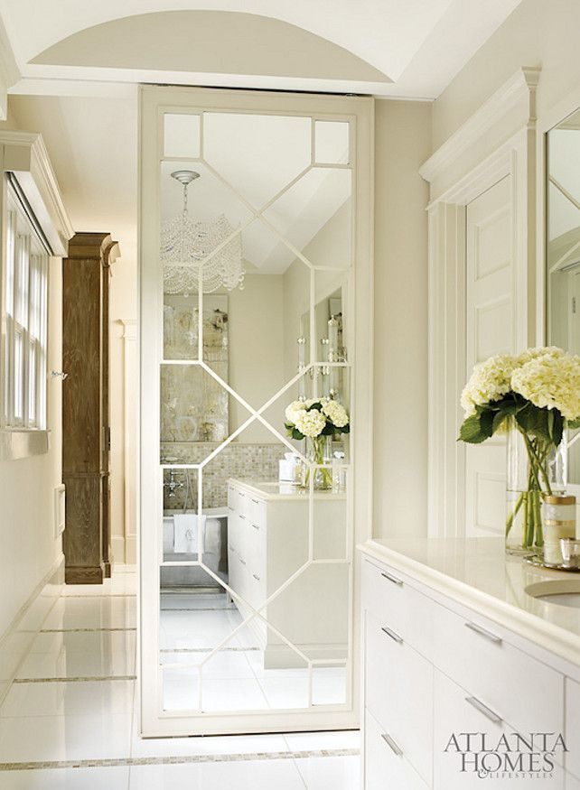 The Best Cream Bathrooms - the reason to note this is the sliding mirrored door + the finishing of the vaulted ceiling