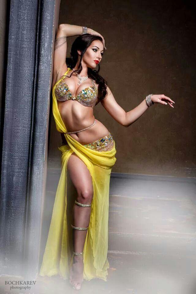 Beautiful yellow and crystal costume. Love the drape