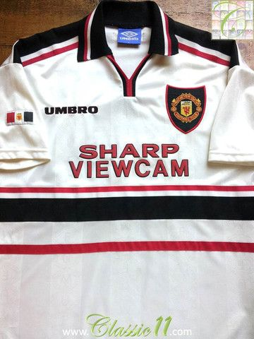 Relive Manchester United's 1998/1999 season with this vintage Umbro away football shirt.