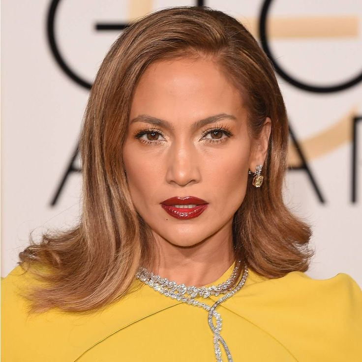 There's something warm and earthy about the lipstick makeup artist Mary Phillips chose for Jennifer Lopez at the 2016 Golden Globes, making them a partner, not a competitor, with the star's copper-silver eyes. By using very little eyeliner, the overall effect is less loud, although of course she still did use plenty of L'Oréal Paris Voluminous Original Mascara. There's a very good reason the lip color is so nuanced. It's actually a blend of three shades: The $10 L'Oréal Paris Infallible…
