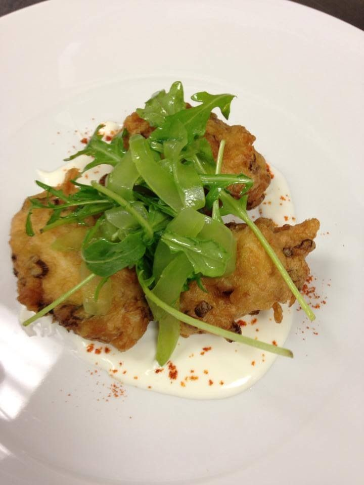 On the happy hour menu:  blue crab fritters with cucumber, creme fraiche and chili powder. Join us 4:30-6:30 for half-priced bar menu.