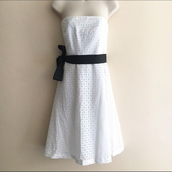 NWT New York & Company white tube dress Size 8 beautiful white cut work tube dress. Comes with a black sash to tie on your side or back, zip closure at the back. Comes from a smoke free pet free home. Bundle for greater discounts! New York & Company Dresses