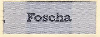 etichette tessute: Ares, etichette tessute per abiti da donna.