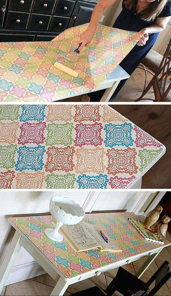 Covering the top of the table with wrapping paper, to give it a stylish revamp. - 17 Genius Ideas to Reuse Leftover Holiday Wrapping Paper