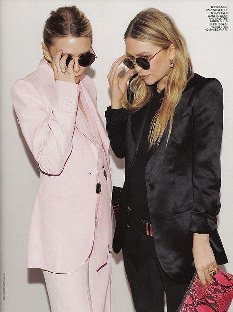 Mary Kate and Ashley Olsen / blush suit vs. black suit / fuchsia snake skin clutch / sunnies