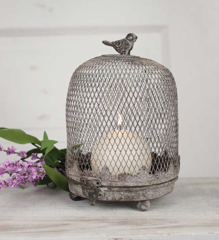 """The Sweetheart-Collette loves cloches ...almost as much as she loves spindles! So we weren't a bit surprised when she chose this precious farmhouse birdcage style cloche for her home and collection!It adds such sweet touch of farmhouse swag!Hinged metal dome opens with a clasp in the front. Rustic finish.5¼"""" dia. x 7¾""""T.Shown with a 3""""round candle, not included."""