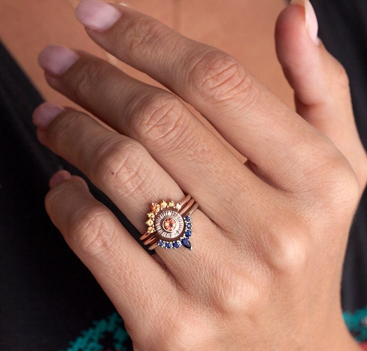 Sunset Ring Set, Unique Wedding Ring Set, Sapphire Ring Set, Sapphire Wedding Rings, Orange Sapphire Ring, Blue Sapphire Wedding Set by MinimalVS on Etsy https://www.etsy.com/listing/466328384/sunset-ring-set-unique-wedding-ring-set