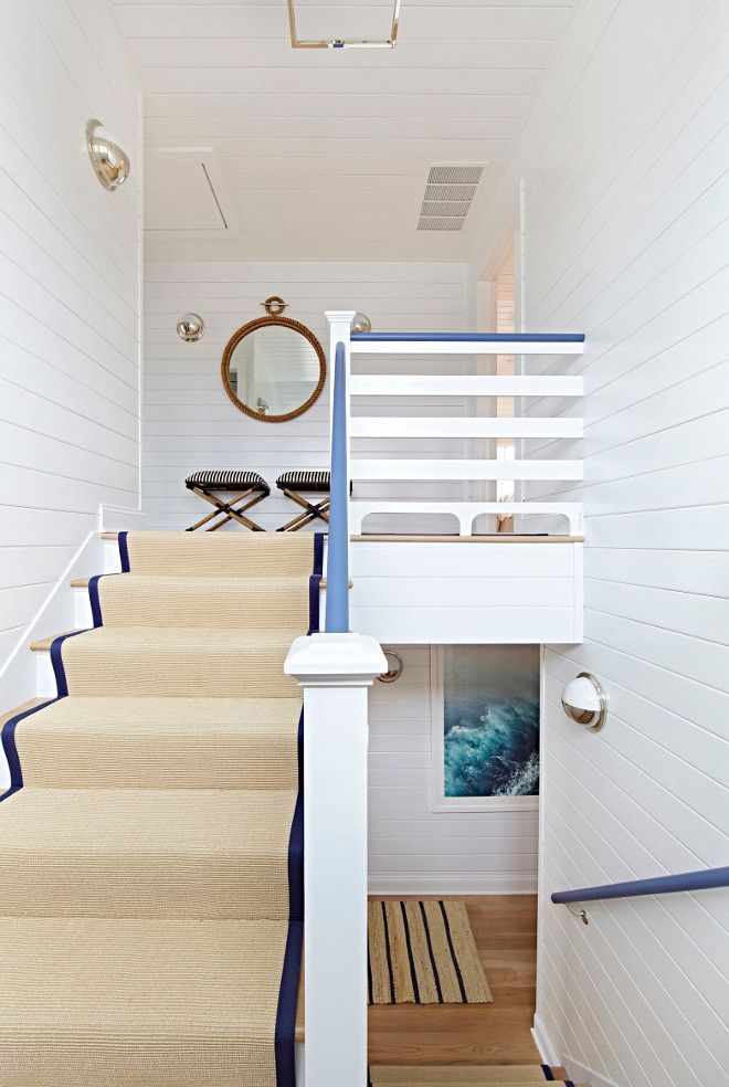 """The staircase features shiplap wainscoting and sisal runner. Staircase railing is painted in """"Benjamin Moore 832 Blue Heron"""". Walls are BM Decorators White."""