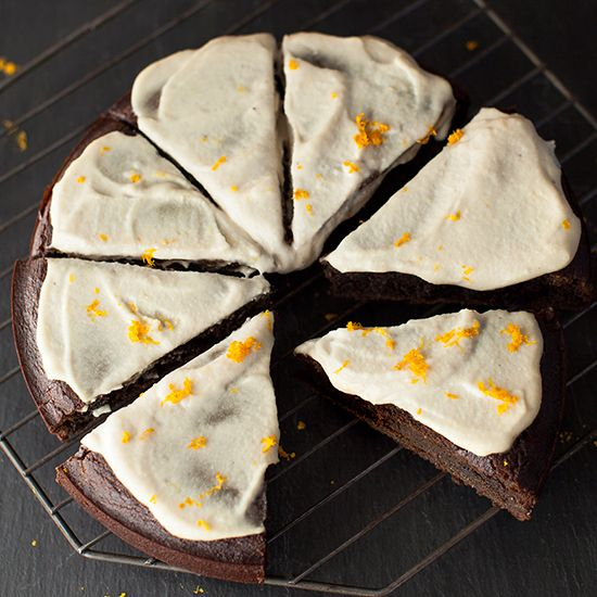 Pumpkin-Gingerbread with Lemony Cashew Cream | This mildly sweet gingerbread cake is dark, dense, and layered with old-fashioned flavors of fresh ginger and molasses. A lemony cashew cream topping makes this holiday cake dairy free.