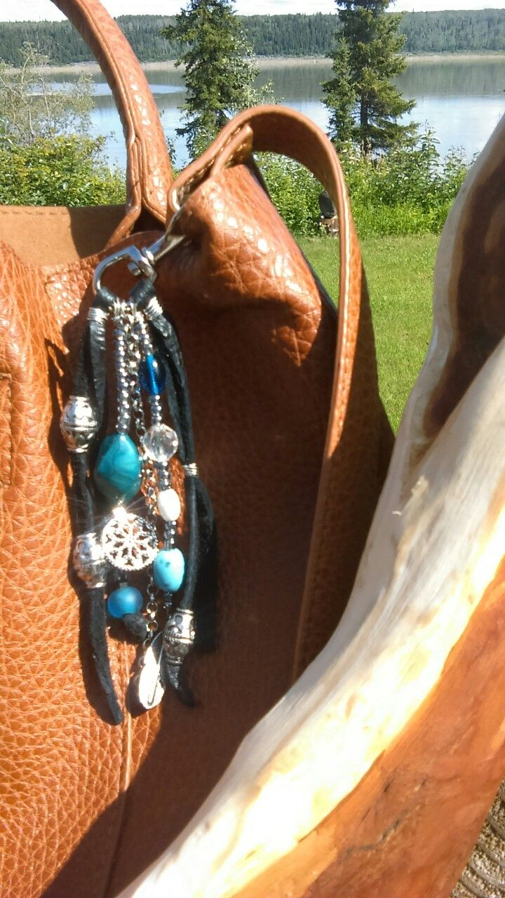 Purse Tassel made with Leather and Upcyled jewelry pieces.