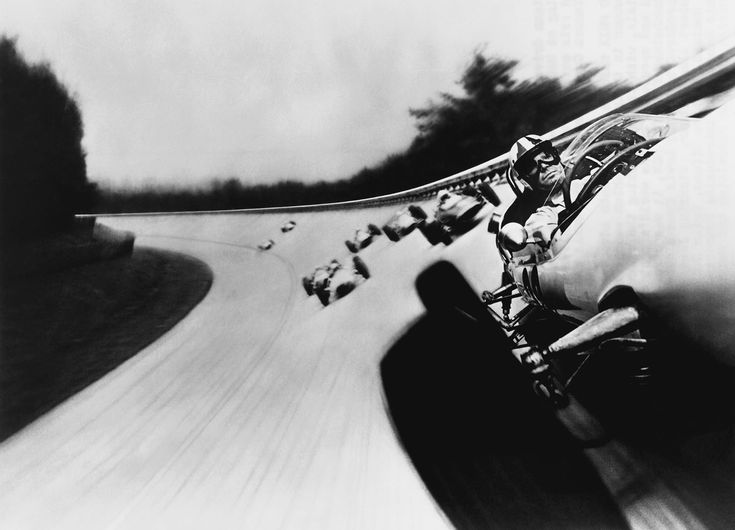 Original caption: Actor James Garner leads the pack of Formula Ones in a still from the 1966 film <i>Grand Prix</i>, the first film to capture the thrill of the track by mounting a camera on a car.