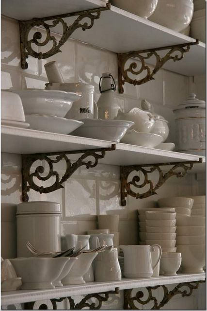 Iron brackets with just plain white boards.  This would be cute at the end of a hall, in a bath or laundry or ANYWHERE.   CotedeTexas