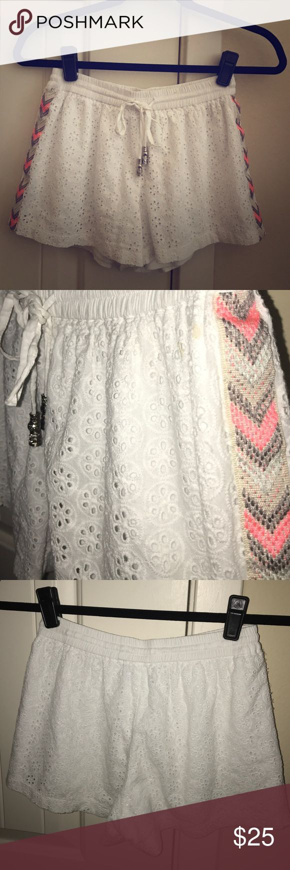 White Eyelet Shorts with Chevron Sides White eyelet shorts with gray/pink/taupe chevron detail down the sides. Drawstrings have adorable silver beads. One very very small stain on the waistband usually hidden by a shirt, but is not very obvious. Will accept offers! Francesca's Collections Shorts