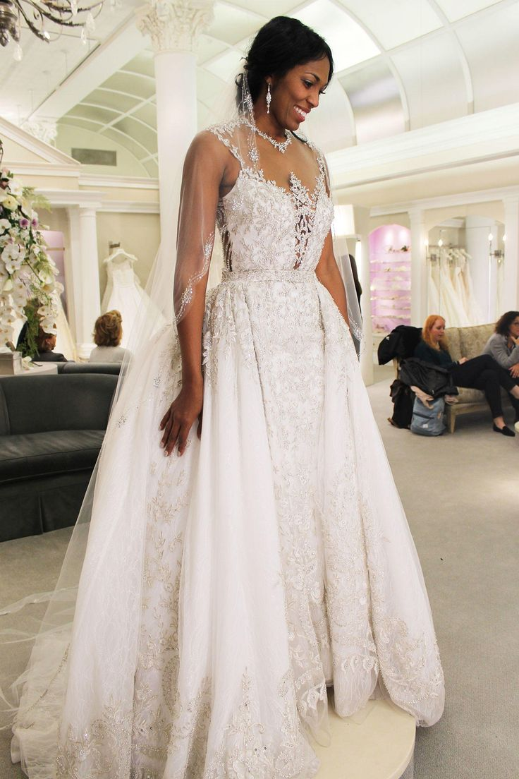 Season 14 Featured Dress: Ysa Makino. Very beaded top and back with illusion. Detachable ball gown. $7,000. Style: 69007.