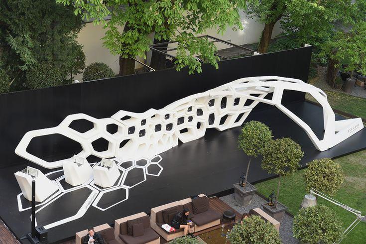 zaha hadid bulgari serpenti installation milan design week designboom | an aerial view of the installation set in the garden of the bulgari hotel