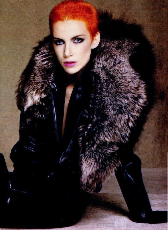 Annie Lennox. Flamboyant Natural all the way. Very cool coloring (which is why she could pull off this harsh, weirdly cool orange hair all those years - and why her natural grey hair suits her so well now) - I'd say she's a Cool Winter.