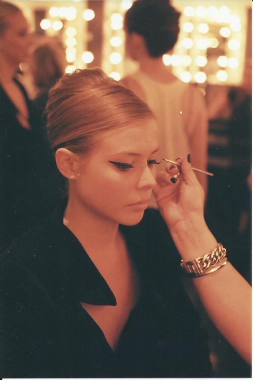 Model backstage getting make up done with 35mm with Minolta x 570