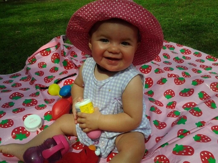 One of our gorgeous customers, Caitlin, using her strawberry Little Mister mat at the park. Available at our online store