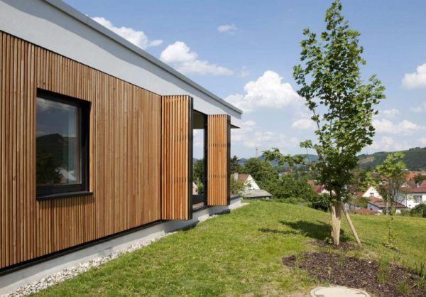 Elegant modern home uses custom wooden shutters in an extravagant manner - Decoist