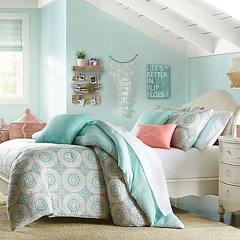 Beach style: Brighten up your bedroom with the lively Wendy Bellissimo Sunrise Reversible Comforter Set. Embellished with detailed medallions in hints of soft sea green, orange and white, the whimsical bedding brings an ornate look to any room's décor.