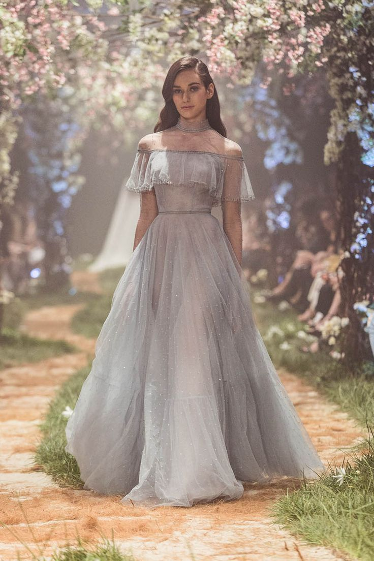 """An off-the-shoulder Cinderella-style light blue fairytale wedding dress with gorgeous smooth flowy skirt // """"Once Upon a Dream"""" – a fairytale collaboration between Paolo Sebastian and Disney, is a magical, mesmerizing 34-piece collection inspired by Disney princesses Cinderella, Sleeping Beauty, Belle, and more. Gowns of French tulle and silk chiffon in soft pastel hues, glittering with hand-sewn embroidery and beadwork, glided down the runway. Colour us enchanted!"""