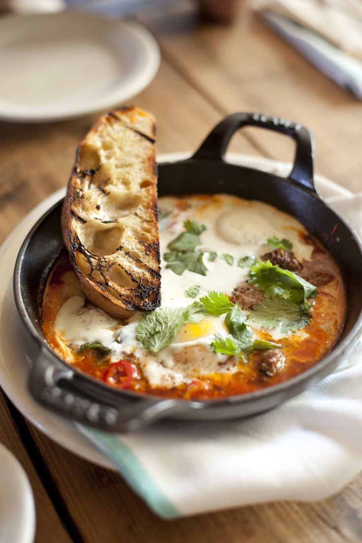 Moroccan Baked Eggs with Merguez, Chili, Tomato Sauce, Cilantro & Spiced Yoghurt AKA eggs in purgatory